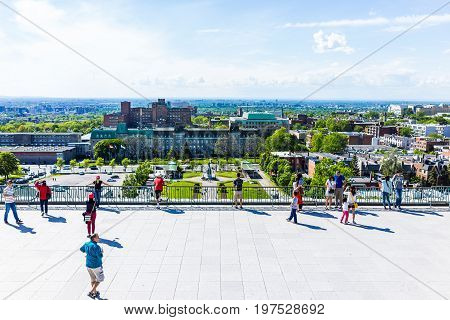 Montreal Canada - May 28 2017: People on steps of St Joseph's Oratory on Mont Royal with view of cityscape or skyline in Quebec region city