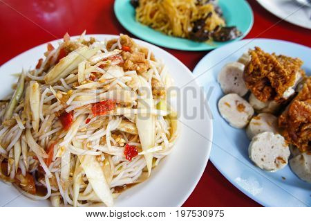 papaya salad som tum food popular with Thai people.