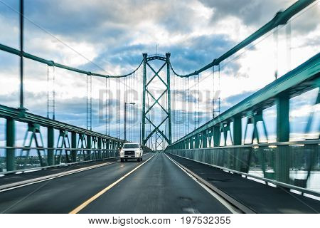 Ile D'Orleans Canada - June 1 2017: Bridge view crossing Saint Lawrence river from Ile D'Orleans Quebec to Boischatel during sunset