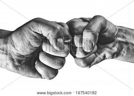 Clash of two fists on white isolated background. Concept of confrontation competition etc.