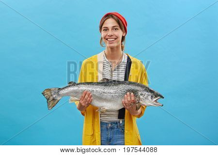 Smiling Glad Female Angler Wearing Casual Clothes Returning From Night Fishing Demonstrating Her Suc