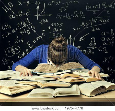 Student Hard Study Tired Bored Woman Read Books over Blackboard Math Formulas Difficult Education