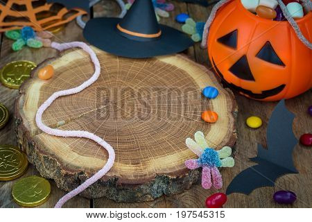 Halloween Jack o Lantern bucket overflowing with candy spooky Halloween decorations horizontal copy space