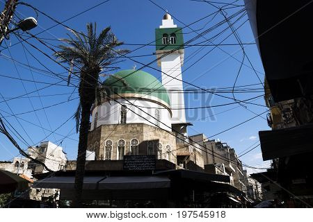 Modern Mosque square minaret with power lines in Tripoli, Lebanon