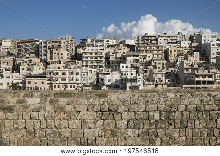 View to the slums with the walls of Citadel of Raymond de Saint-Gilles with cloud, Tripoli, Lebanon