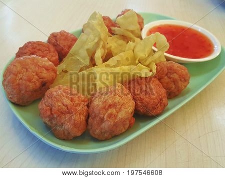 shrimp seafood meatball served with crispy fried wonton on plate / shrimp meatball