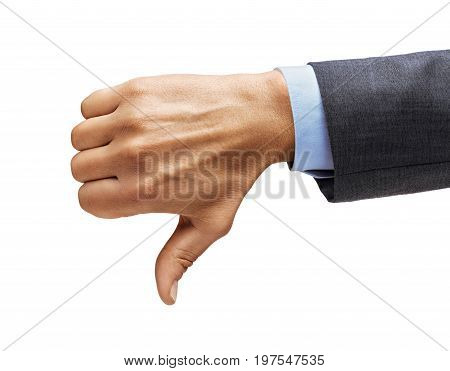 Men's hand in a suit shows thumb down isolated on white background. Negative concept. Close up. High resolution.