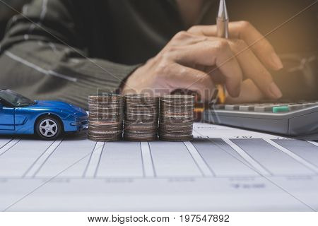 Hand pressing button calculator with car insurance and car services concept. Business concept. Car insurance concept.
