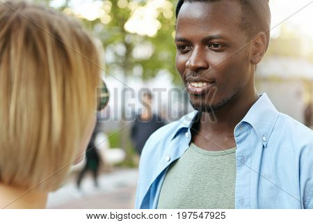 Handsome Guy With Black Skin Meeting His Female Friend On Street Having Pleasant Conversation On Str