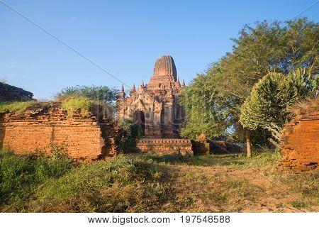 Sunny morning at the ruins of an ancient Buddhist temple. Bagan, Burma