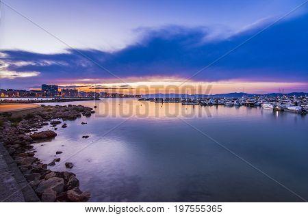 Sunset or blue hour in quiet port of l'Escala, Costa Brava, Spain. Mediterranean Sea