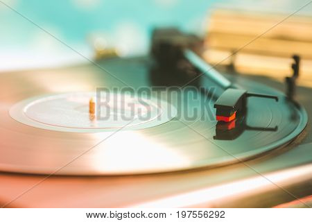 Old turntable with a record in playing