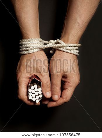 Tobacco Addiction. Cigarettes On Male Hands Tied With A Rope