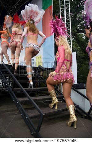 Moscow Russia July 28 2013: Girls dancers in carnival costumes climb the stage.