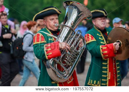 PETERHOF/ RUSSIA - JULY 1, 2017. Musicians of the Imperial wind orchestra playing in the Peterhof park. Saint Peterbug, Russia.