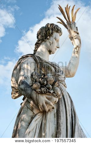 Florence ITALY - July 18 2017: the statue of Abundance which was partly sculptured by Giambologna and completed by Pietro Tacca and Sebastiano Salvini (1608 - 1637). White marble with wheet bouquet of bronze. It is located in the Boboli Garden.
