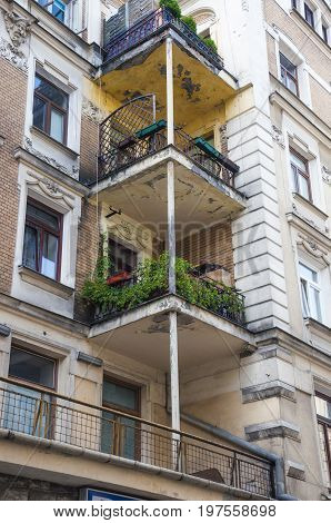 three balconies on a tenement building in downtown