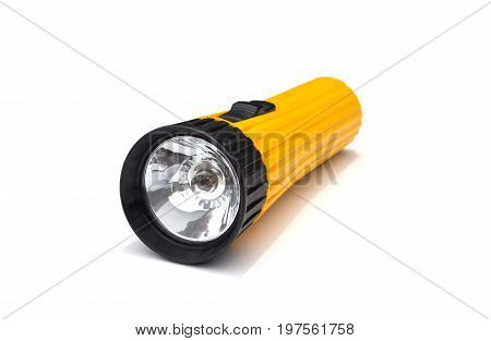 yellow electric flashlight with simple design isolate on white background. flashlight isolated