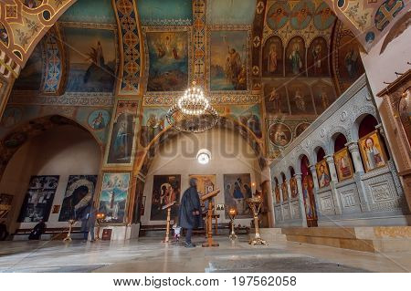 MTSKHETA, GEORGIA - OCT 13, 2016: Arches with paintings and tall walls of old church of Shio-Mgvime monastery on October 13, 2016. Christian monastery built in 6th century
