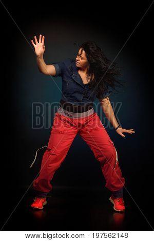 young woman dancing during zumba class