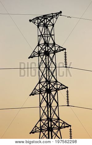 Power Transmission Line With Yellow Sky