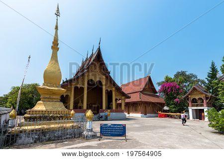 LUANG PRABANG LAOS - MARCH 11 2017: Golden temples close to Wat Xieng Thong located in the city Luang Prabang Laos