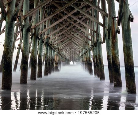 Ghostly waves under the Folly Beach pier