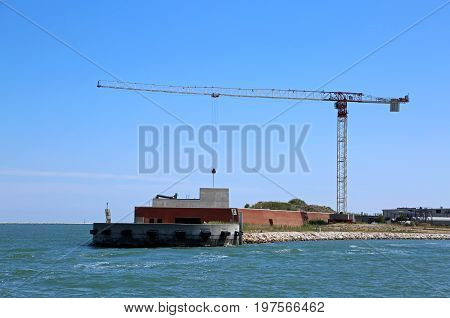 Big building called Mose is a project to protect Venice and other islands from flooding in the Adriatic Sea poster