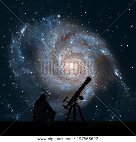 Man With Telescope Looking At The Stars. Pinwheel Galaxy Messier