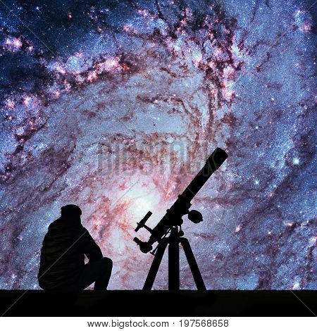 Man With Telescope Looking At The Stars. Messier 83, Southern Pinwheel Galaxy, M83 In The Constellat