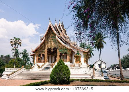 Wide angle picture of Haw Pha Bang located on the grounds of the Royal Palace Museum in Luang Prabang Laos.