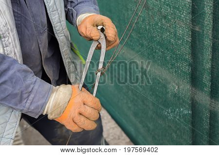 Tightening Wire Using A Pincers 2