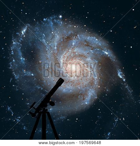 Space Background With Silhouette Of Telescope. Pinwheel Galaxy M