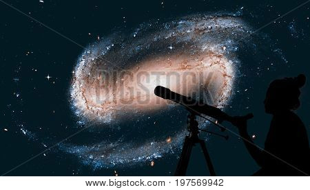 Girl Looking At The Stars With Telescope. Spiral Galaxy In The Constellation Eridanus Ngc 1300 .elem