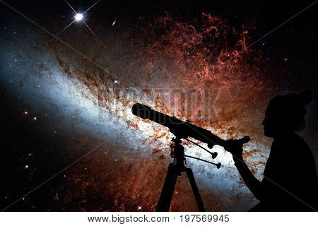 Girl Looking At The Stars With Telescope. Messier 82, Cigar Galaxy Or M82 In The Constellation Ursa