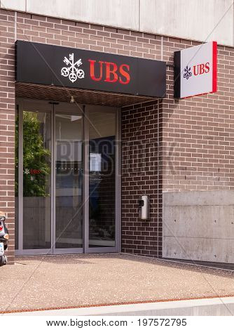 Wallisellen, Switzerland - 30 July, 2017: entrance to the office of the UBS bank on Bahnhofstrasse street in the town of Wallisellen in the Swiss canton of Zurich. UBS AG is a Swiss global financial services company.