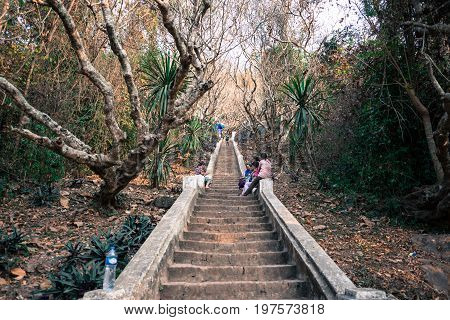 LUANG PRABANG LAOS - MARCH 11 2017: The Thanon Phousi staircase consists of 355 steps to reach to the top of Mount Phousi in Luang Prabang Laos.