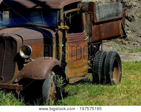 A rusty, old, vintage truck from a bygone era.