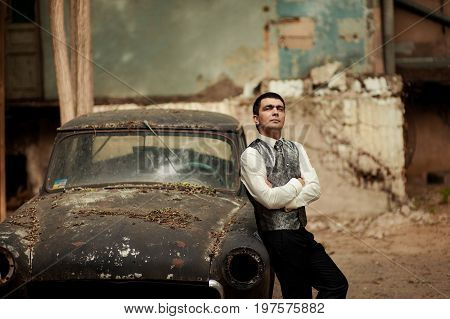 Beautiful Imamous Groom Standing By The Old Black Car