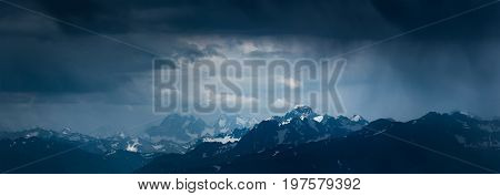 Mountain landscape before storm. Mounts Sofiya and Karakaya. Dramatic overcast sky.  Landscape in blue tone. Caucasus Mountains. Karachay-Cherkessia. Russia.
