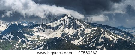 Top of mount Zakzan-Syrt covered by snow. Greater Caucasus Mountain Range. Karachay-Cherkessia. Russia.