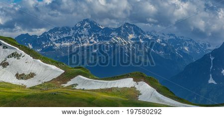 Ridge Zagedan and Mount Dzichekish. Landscape in blue-green tones. Caucasus Mountains. Karachay-Cherkessia. Russia.