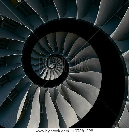 Isolated on black turbine blades wings spiral effect abstract fractal pattern background. Spiral industrial production metallic turbine background. Turbine manufacturing technology abstract fractal