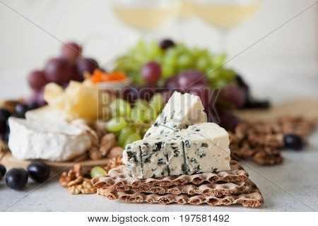 Cheese Plate Served With Grapes, Jam, Cured Melon, Crackers And Nuts