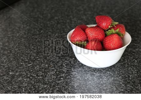 Appetizing Fresh Strawberry In A White Bowl On A Gray Background.