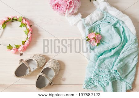 Girl's Dress, Floral Tiara And Shiny Shoes On A Wooden Background.