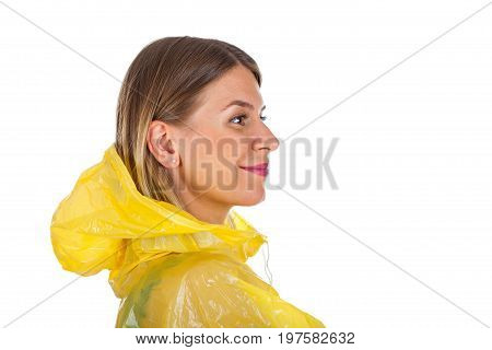 Picture of attractive caucasian woman wearing a yellow raincoat posing on isolated background