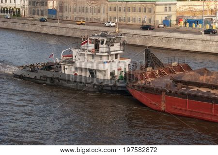 Water Transport. River Boat Tow Pusher In The Canals Of The Moscow River Against The Backdrop Of The