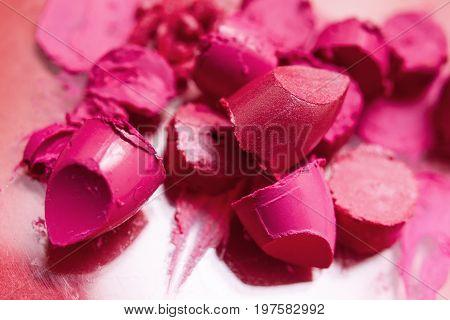 Lipstick pink samples of smeared cosmetics. Colorful fashion, beautiful style closeup, glamorous magazine, creative advertising, beauty concept