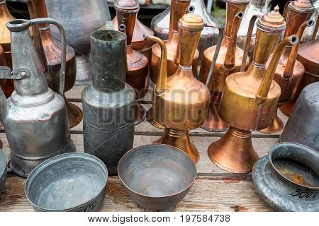 Antique copper and bronze jugs and dishes at antique shop at oriental marketplace